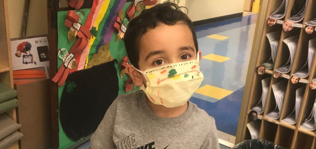 Pre-K student showing off his homemade face mask