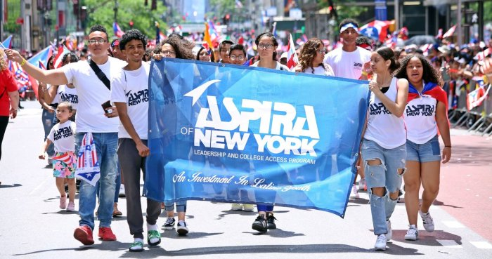 Teenagers carrying the ASPIRA of New York banner during the Puerto Rican Day Parade
