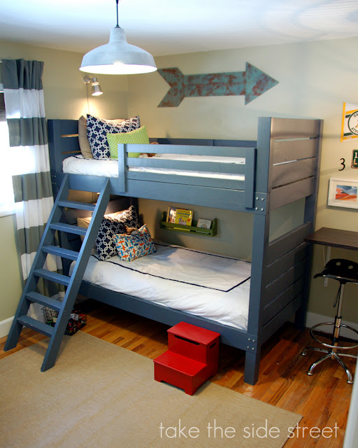 this is another basic design for a bunk bed it is very traditional as they are stacked beds and the ladder comes off of the side