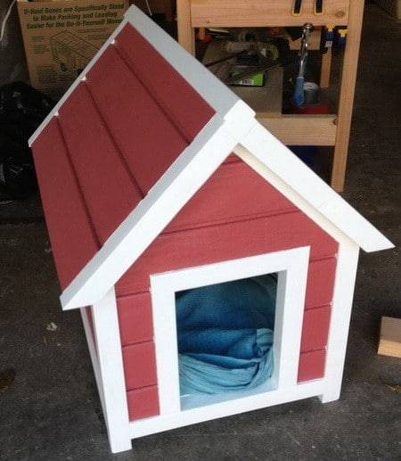 This Dog House Fits The Stigma Of A Basic Dog House Design. It Is Smaller  And Looks Like An A Frame House.