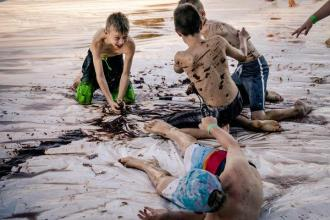 Boys mud fight