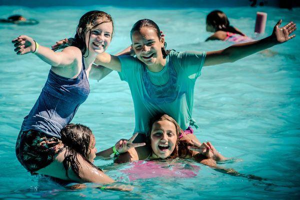 Girls camp pool fun group