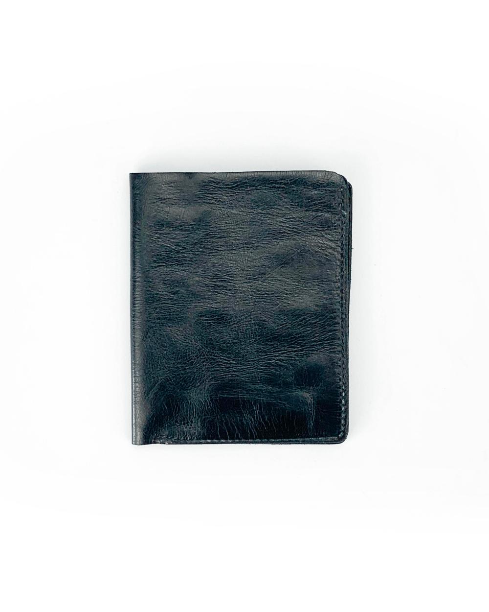 Portafoglio verticale in pelle tinta in capo nero