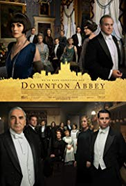 Downton Abbey film poster - the cast of characters dressed in their Edwardian finery.