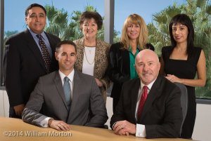 executive group portrait of Epstein and White Retirement Income Solutions demonstrates a more formal company culture