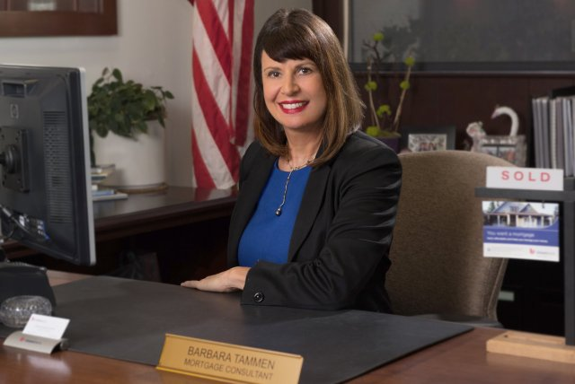 San Diego mortgage banker photographed in her office for bank advertising