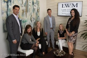 casual company culture illustrated in office group portrait of Labrum Wealth Management