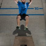 Michael Gonzalez does a jumping workout with the support of Crossfit East Village