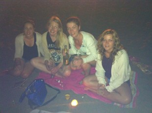 Celebrating the girls' amazing degree results with cava on the beach at night!