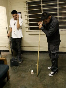 Christopher Moreno kills a cockroach in Washburn hall as Raphael Santa Maria watches on at San Jose State University in San Jose, Calif. on Tuesday, June 18, 2013. (Kelly Chang/Mosaic Staff)