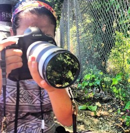 Mosaic journalist Marili Arellano photographs plants outside the San Jose Flea Market in San Jose California on Saturday June 22, 2013.
