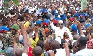 Guinea president Alpha Condé surrounded by supporters