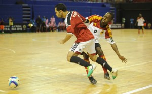 Ibrahim Ibrahim  of Egypt is tackled by Celso Martins  of Angola  during the CAF Futsal Africa Cup of Nations match between Egypt and Angola  on 18 April 2016 at Ellis Park Stadium Pic Sydney Mahlangu/ BackpagePix