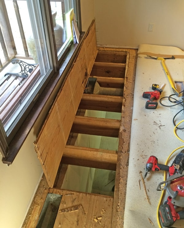 How To Move A Stairwell Mosby Building Arts Right Bath   Open Concept With Basement Stairs In Middle Of House   Dining Room   Ceiling   Feng Shui   Kitchen   Stair Case