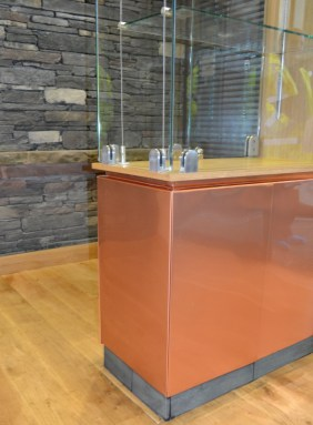 Lacquered copper and glass display cabinet
