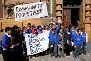 Schoolkids with 'save moseley road baths banner