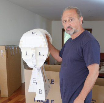 Yuroz with paper model of Eternity sculpture