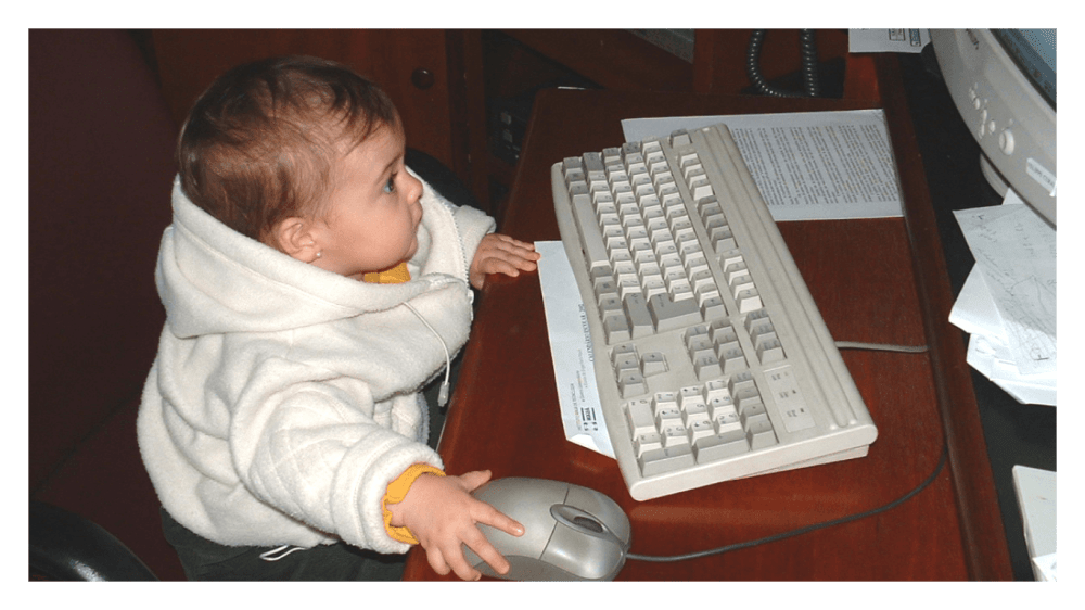 child writing on a computer