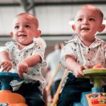 twins riding a trike