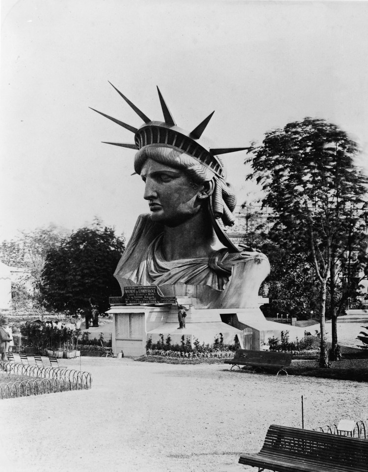 The head of the Statue of Liberty on display in the garden at the Champ de Mars at the World's Fair in Paris to drum up support and contributions for the completion of the great project, 1878. (Photo by FPG/Getty Images)