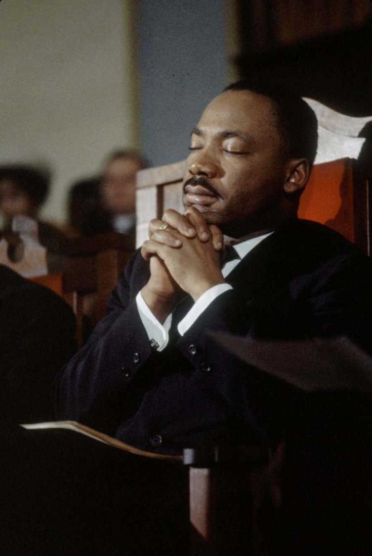 American religious and Civil Rights leader Martin Luther King Jr (1929 - 1968) leads a prayer in a church before the second Selma to Montgomery Civil Rights march, also known as 'Turnaround Tuesday', Selma, Alabama, 9th March 1965. (Photo by Frank Dandridge/The LIFE Images Collection/Getty Images)