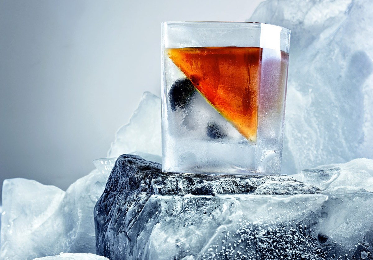 Glass of whiskey. On the iceberg, ice everywhere.Creative photo of alcohol.Advertisng shot.Copy space.Whiskey wedge
