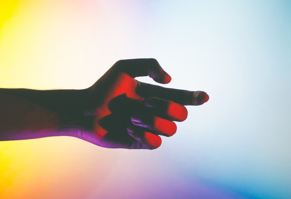 andre Elliott hand under neon light