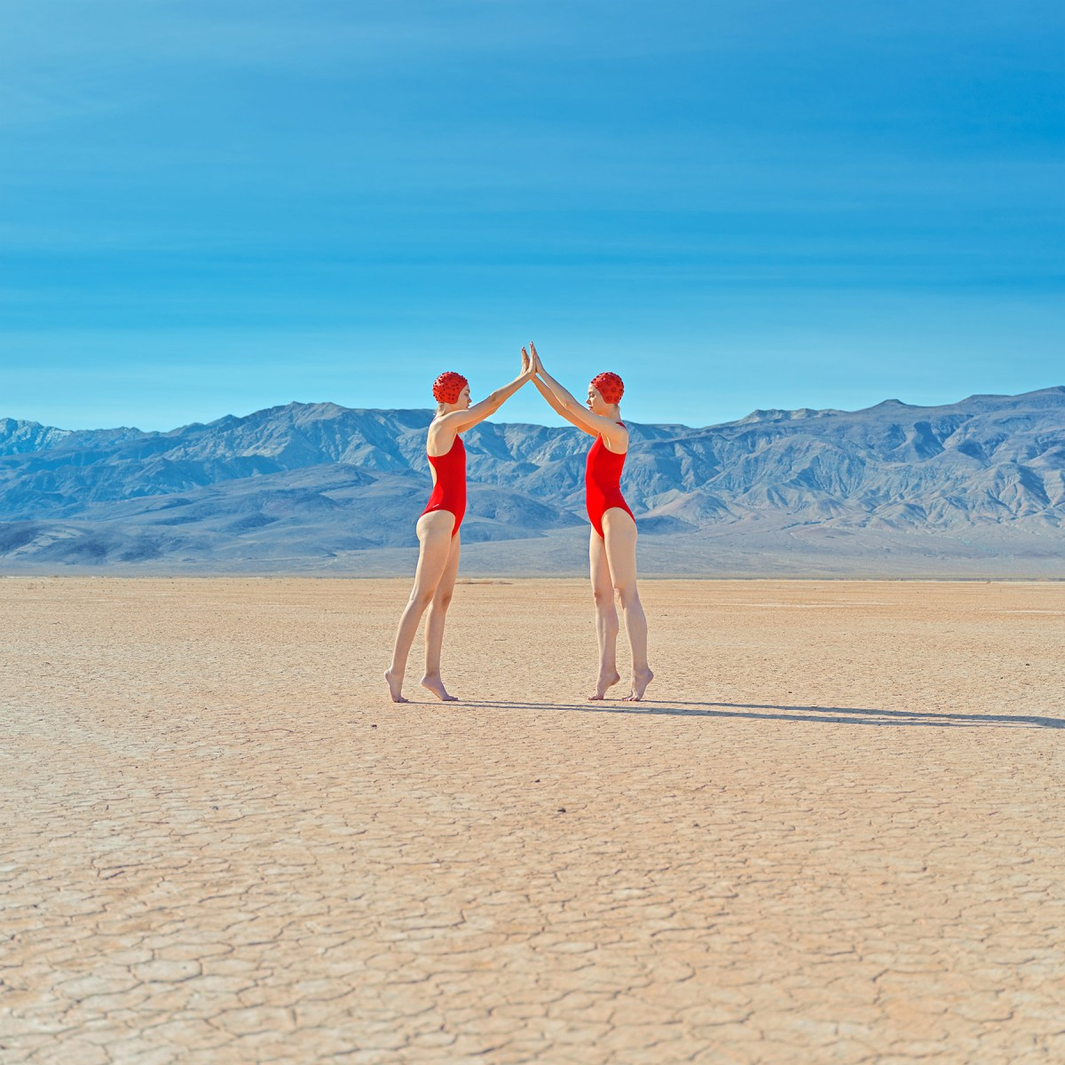 swimmers in the desert