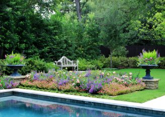 Hilary Smith, our Seasonal Color Specialist designed this beautiful arrangement of Pentas, Angelonia, Drift Roses, Portulaca and Blue Daze.
