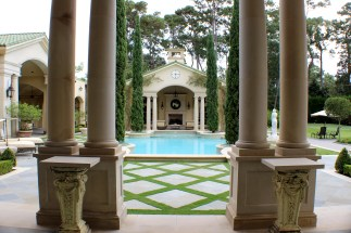 Four Italian Cypress anchor the pool while two Cherokee Climbing Roses crawl the wall of the outdoor pavilion.