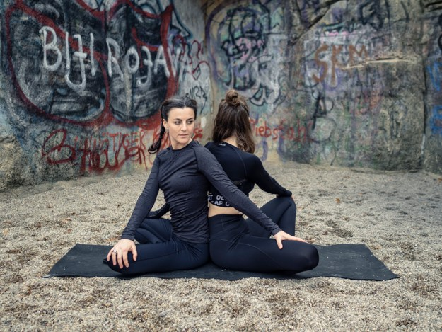 yoga poses for 2 people - Partner Seated Twist