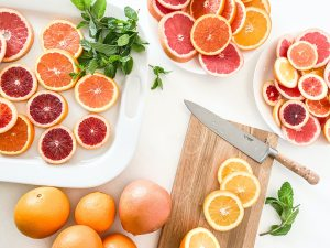 How to Reduce Food Waste | Above shot of citrus foots chopped laying on plates and cutting boards.