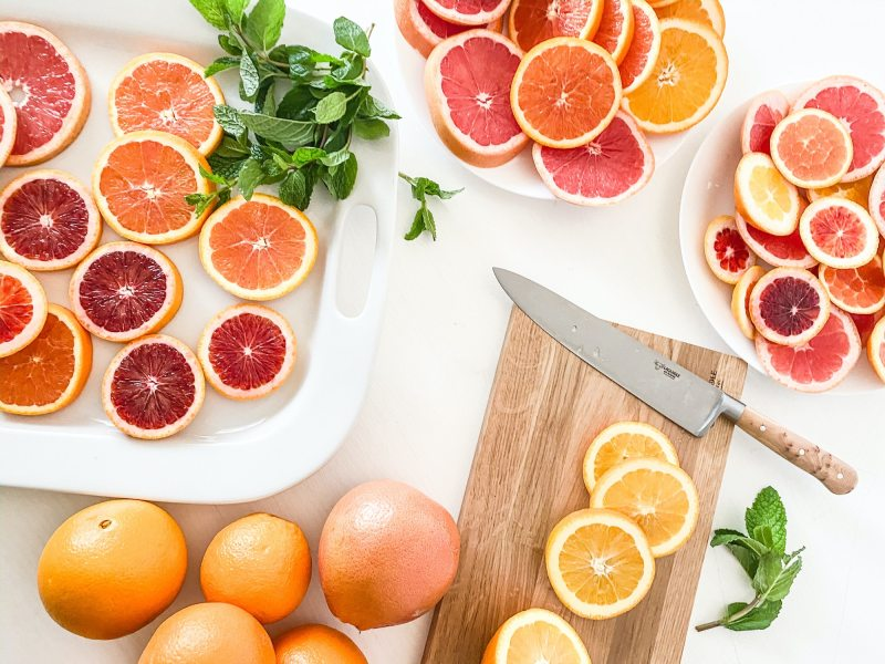 How to Reduce Food Waste   Above shot of citrus foots chopped laying on plates and cutting boards.