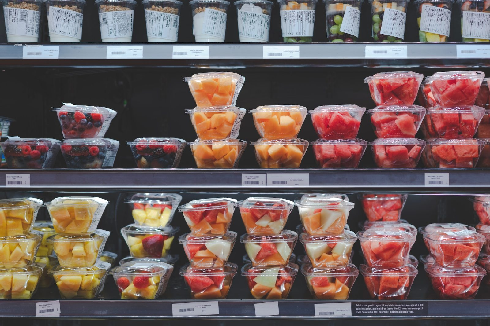 How to Reduce Food Waste   Pre packaged fruits on grocery store shelves.
