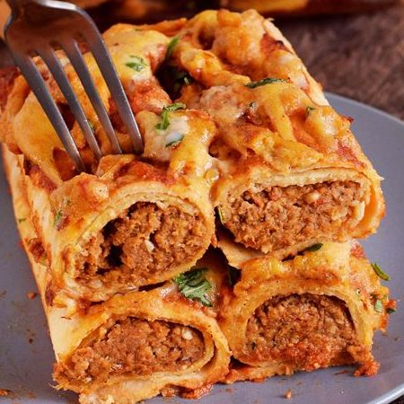 Easy Vegan Recipes | Lentil enchiladas stacked on a plate