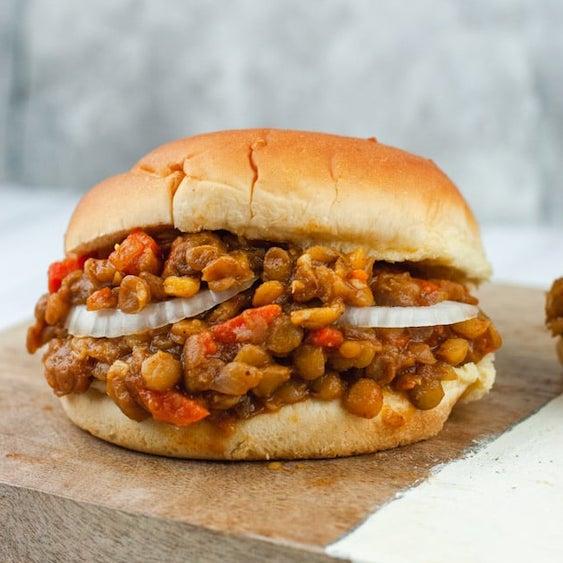 Easy Vegan Recipes | Lentil sloppy joe served on a wood cutting board.