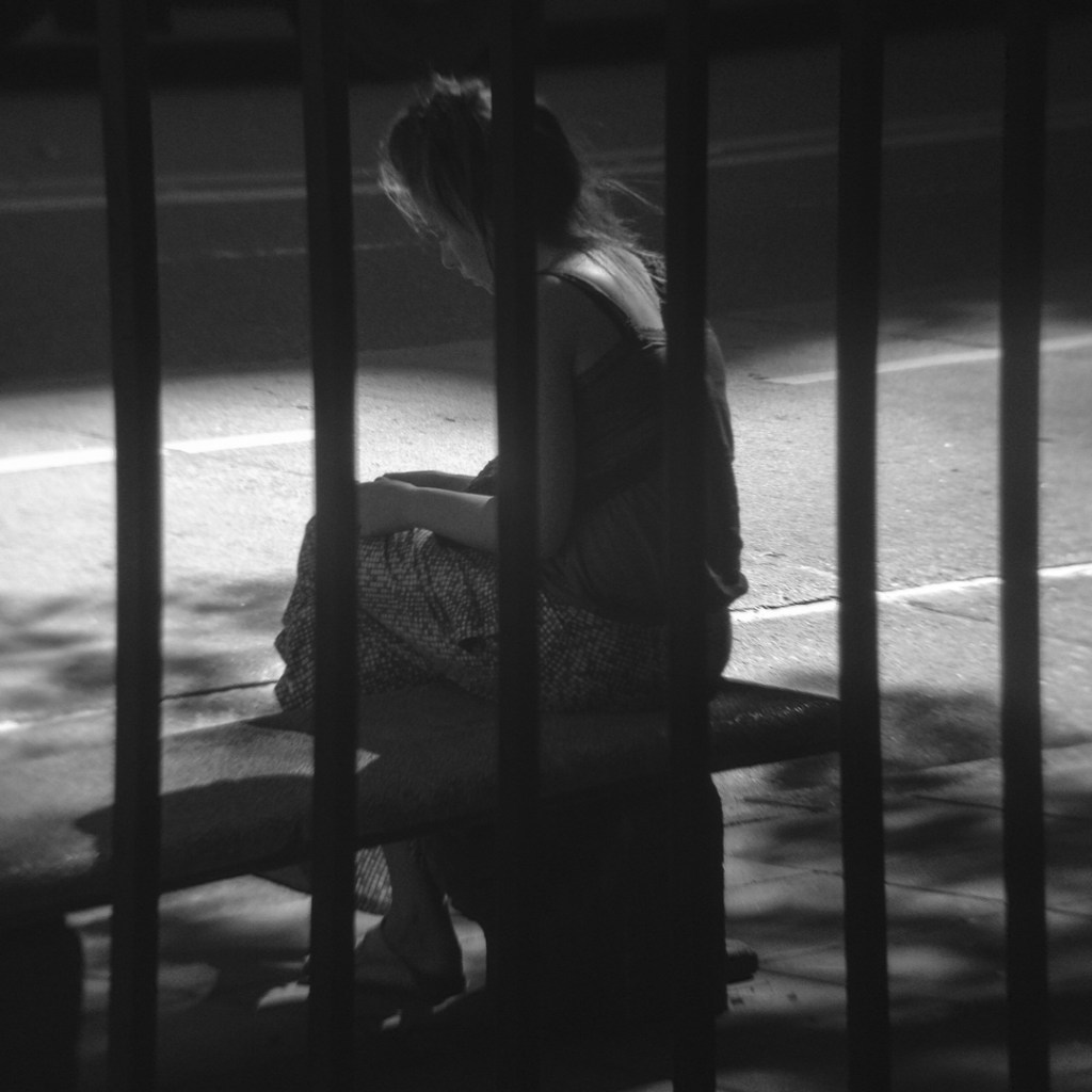 Girl through bars