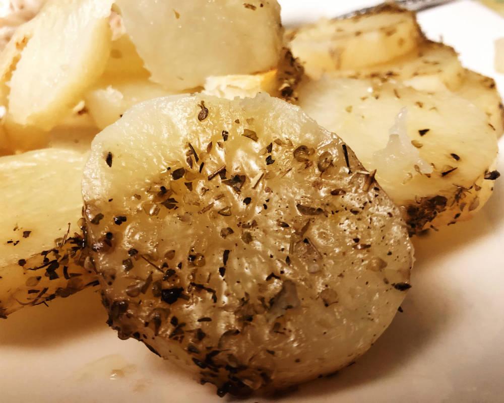 close up of potato with oregano