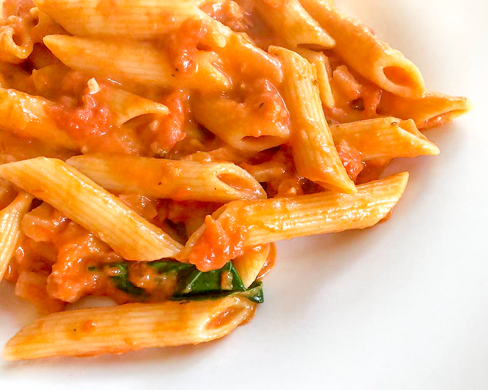 penne alla vodka detail with basil