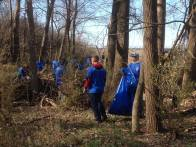 MCC-Longview Student Government President and unofficial site co-leader Colton Hilbrenner with a few of the nearly 100 student volunteers cleaning up the old Honeywell site along Blue River Road. The most surprising find: a 60-foot long wall of discarded glass bottles, many over 50 years old, in a hidden ravine. We got out all the unbroken bottles and many of the broken ones, but we'll need to come back with a fresh stash of mesh bags to attack the mounds of remaining broken glass.