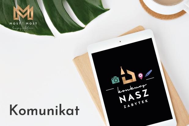 """Grafika: w lewym dolnym rogu podpis """"komunikat"""". Po prawej stronie tablet z logo konkursu """"Nasz Zabytek"""" na ekranie. W lewym górnym rogu logo fundacji Most the Most."""