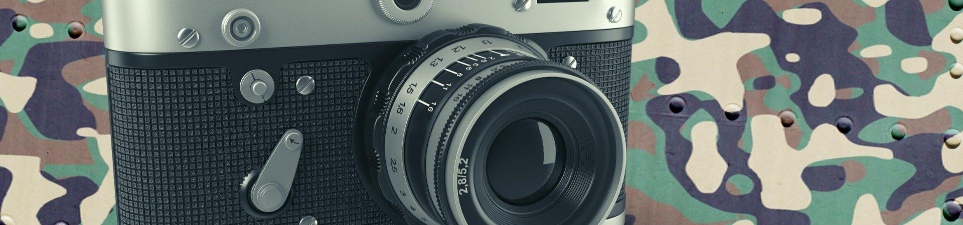 vintage camera on camo background