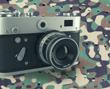 vintage camera on camo background