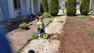 Jaxson on his all terrain tricycle.
