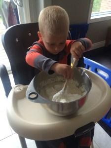 Wes stirring the batter