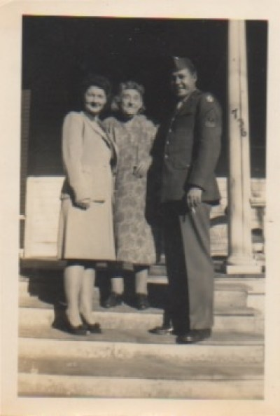 Patriotism runs deep in my family. Here's my great grand uncle Harold who fought in WW II with his mom and wife.