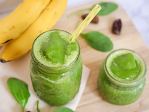 green smoothie in glass cup