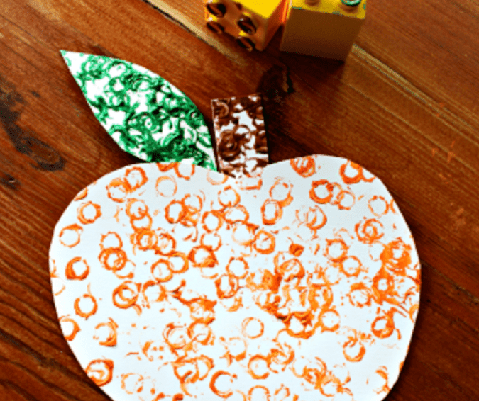 Lego Stamped Pumpkins - Halloween Crafts for Toddlers