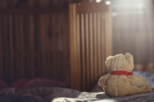 Teddy bear in an empty nursery-bereavement care