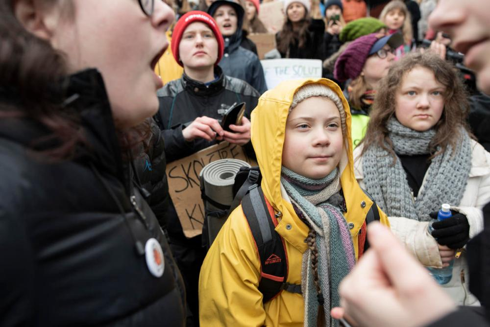 Swedish climate activist Greta Thunberg at the demonstration. The Fridays for Future is an international movement of school students who are deciding not to attend classes and instead take part in demonstrations to demand action to prevent further global warming and climate change. © Christian Åslund / Greenpeace